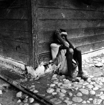 insane_asylum_haiti_holding_head